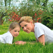 Young mother and daughter laying — Stock Photo #2306079