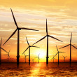 Wind turbine on sunset — Stock Photo #5599436
