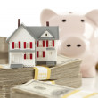 Small House and Piggy Bank with Stacks Money — Stock Photo #6547902