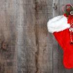 Christmas sock and wreath on wood — Stock Photo #7574178