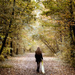 Sad woman walking alone in the woods — Foto de Stock   #9981514