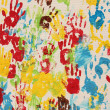 Handprints in different colors in a mural. — Stock Photo #3339360