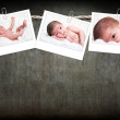 Cute baby photos hanging on rope — Stock Photo #2966202