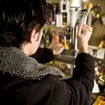 Man working in workshop — Stock Photo #4194437