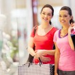 Two happy friends shopping in mall — Stock Photo #14904323