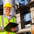 Happy middle aged oil industry worker — Stock Photo #27584981