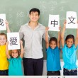 Male chinese teacher with group multiracial students — Stock Photo #28926933