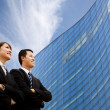 Business team standing together in front of modern building — Stockfoto #4346184