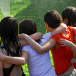 Group of girls and sprinkler — Stock Photo #7612095