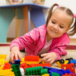 Little girl is playing with toys in preschool — Stock Photo #8363416
