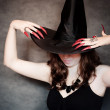 Witch with black hat and long nails — Stock Photo #6825979