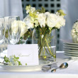 White place card on outdoor wedding table — Stock Photo #3402295