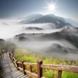 Dramatic clouds with mountain and tree — Stock Photo #9385411