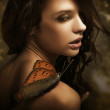 Portrait of a beauty brunette with butterfly — Stock Photo #4581337