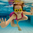 The girl smiles, swimming under water in the pool — Stock Photo #5588990