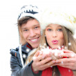 Fantasy happy winter couple blowing a christmas wish — Stock Photo #6361771