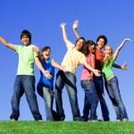 Piggyback diverse group teens — Stock Photo #6361995