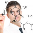 Young teacher during chemistry classes — Stock Photo #4107022