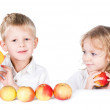 Two kids playing with apples isolated on white background — Stock Photo #8758646