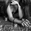 Young sexy girl in casino — Stock Photo #34268319