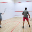 Squash players in action on a squash court (motion blurred image — Stock Photo #7421333