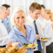 Smiling business woman during company lunch buffet — Stock Photo #10888132