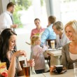 Women friends enjoying a drink at cafe — Stock Photo #12729300