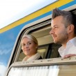 Man and woman looking out train window — Stock Photo #17417287
