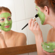 Body care series - Young woman applying facial mask — Stock Photo #4682005