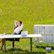 Businesswoman in sunny meadow relax nature office — Stock Photo #6813274