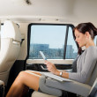 Executive businesswoman in car work touch tablet — Stock Photo #7357598