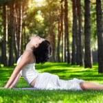 Yoga cobra pose in the park — Stock Photo #18446501
