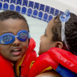 Two brothers playing in the pool — Stock Photo #4746843