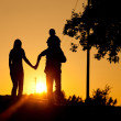 Family having a walk at sunset — Stock Photo #5024598