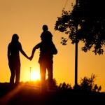 Family having a walk at sunset — Stock Photo #5024598