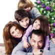 Happy family near Christmas tree — Stock Photo #27398731