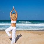 Healthy yoga exercise on the beach — Stock Photo #6377542