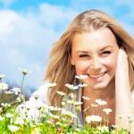 Happy girl enjoying daisy flower field — Stock Photo #6381776