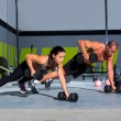 Gym man and woman push-up strength pushup — Stock Photo #18028599