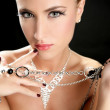 Ambition and greed in fashion woman with jewelry — Stock Photo #5499436