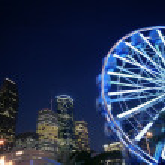 Ferris wheel at the fair night lights in Houston — Stock Photo #5509116
