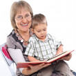 Grandmother and grandson reading a book — Stock Photo #5363691