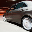 Side view of a car driving fast — Stock Photo #7447610