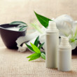 Face/body care concept: bottles of creams/lotions/serums with wh — Stock Photo #9083912