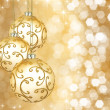 Three beautiful golden christmas balls on a golden background — Stock Photo #9473368