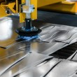 Machine cutting steel in a factory — Stock Photo #35347917