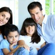 Family relaxing in sofa at home — Stock Photo #13937257