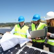 Group of engineers meeting on building roof — Stock Photo #18217745