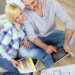 Couple looking at new home construction plan — Zdjęcie stockowe #27877943