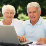Senior couple surfing on internet — Stock Photo #6702678